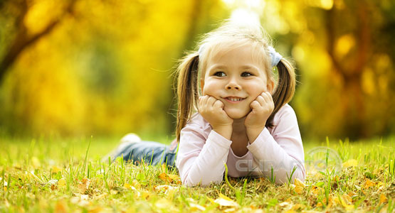 Cute little girl in autumnal park